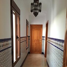 The corridor towards the corner and balcony room